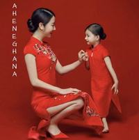 Chinese lady and girl in red outfit